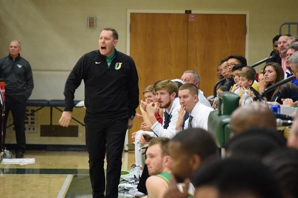 In the Intercity game vs. Bloomington High School, Coach McDowell tells the Pioneers to get back on defense.