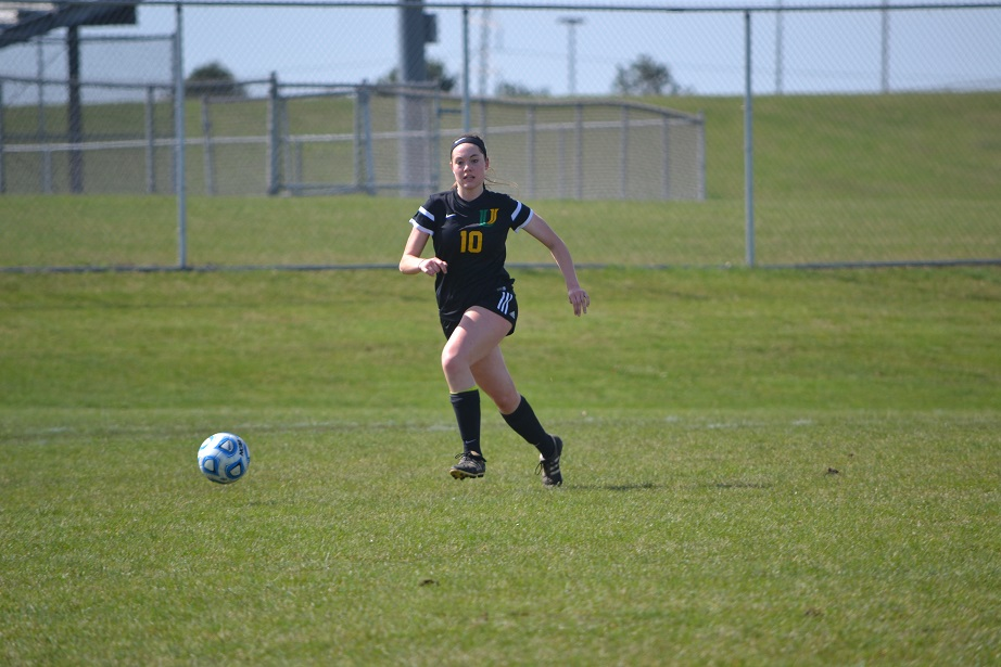 During the Intercity soccer game vs. Normal Community senior Elena Hollingsworth moves the ball up the field.