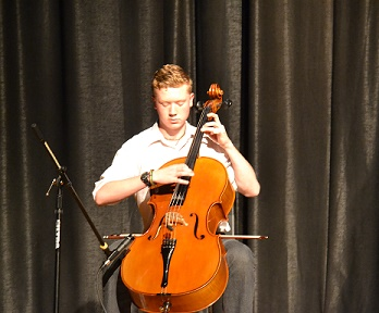 Ethan Schlenker swept the talent portion of Mr. U-High with his cello performance.