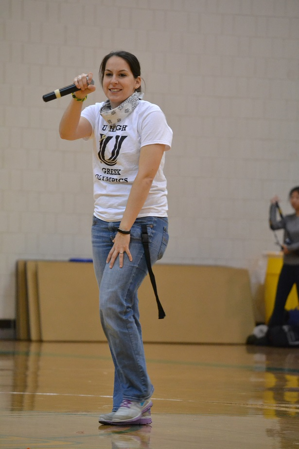 Biology teacher Melissa Doellman encourages freshman while they participate in the 2016 Greek Olympics.