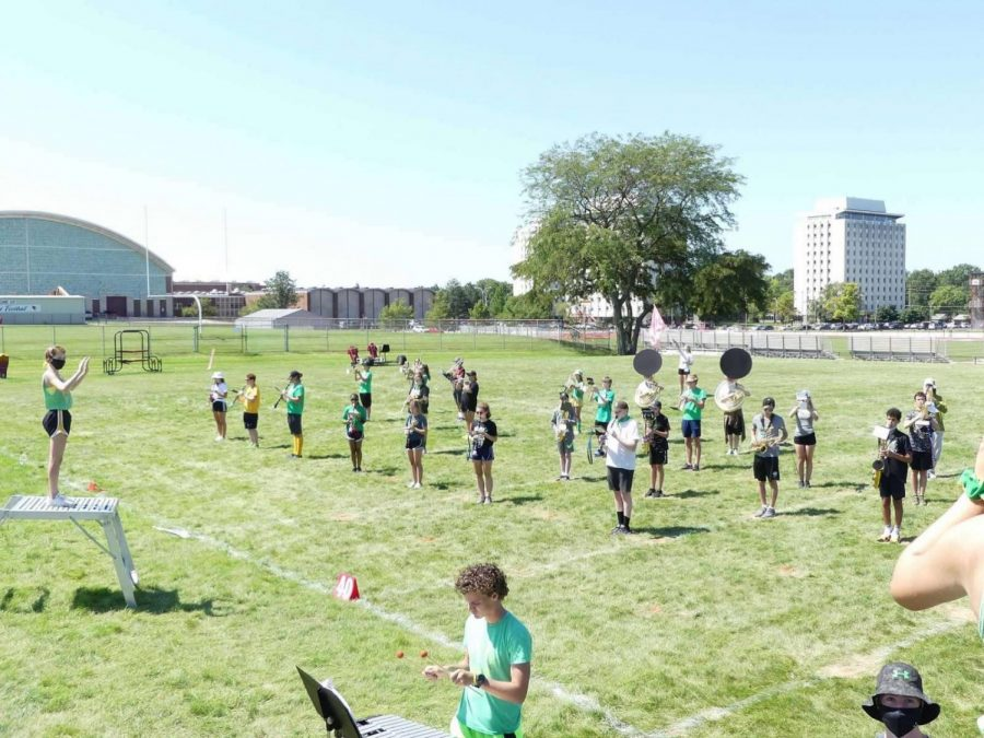 Junior drum major Abby Keene conducts the socially-distant band from her podium.